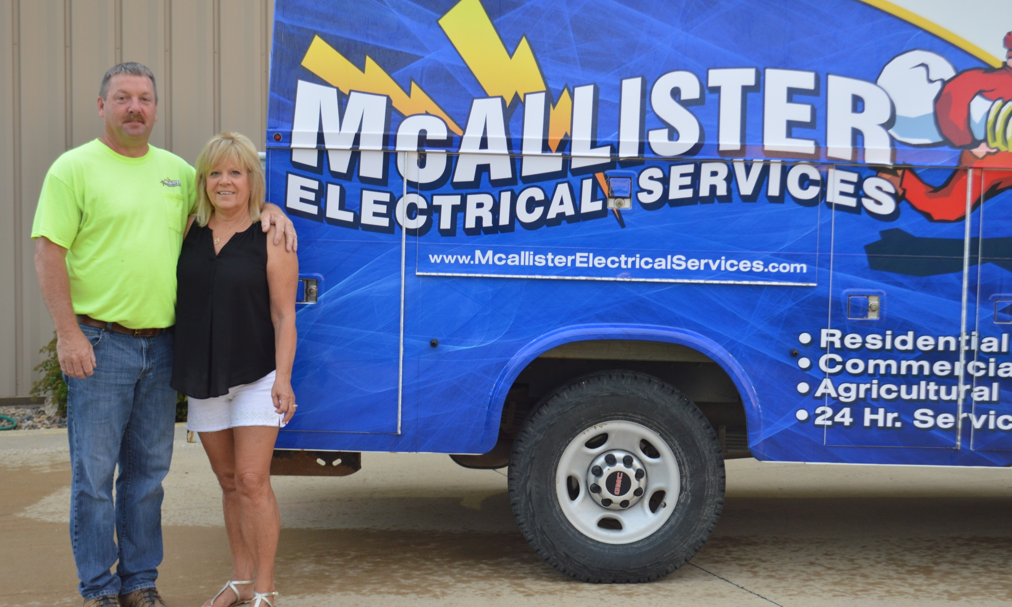 Owners Pete and Chris McAllister appear in front of a company service van